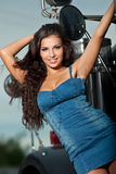 Young pretty girl portrait near steel truck Stock Images