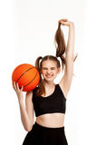 Young pretty girl posing with basketball, isolated on white background. Young emotional pretty girl posing with basketball, isolated on white background. Copy Stock Photos
