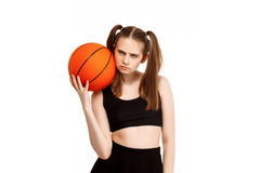 Young pretty girl posing with basketball, isolated on white background. Young emotional pretty girl posing with basketball, isolated on white background. Copy Royalty Free Stock Image