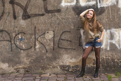 Free Young Pretty Girl Posing Near A Stone Wall. Walk. Royalty Free Stock Photography - 52349637