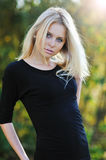 Young pretty girl posing outdoors - portrait Royalty Free Stock Photo