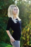 Young pretty girl posing outdoors - portrait Royalty Free Stock Photography