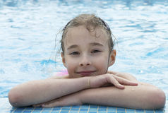 Young pretty girl posing in pool Stock Photos