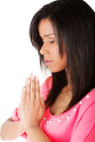 Young pretty girl praying Royalty Free Stock Photos