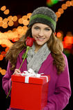 Young pretty girl with present and rose Stock Photo