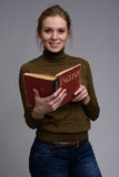 Young pretty girl reading english textbook. Language school concept Stock Photography