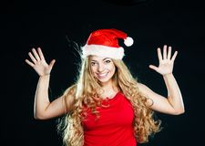 Young pretty girl in Santa hat Stock Images