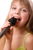 Young pretty girl singing at microphone royalty free stock image
