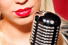 Young pretty girl sings. Young blonde girl with an appearance as a singer Stock Photo