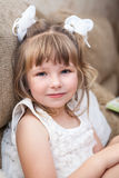 Young pretty girl sitting on sofa Royalty Free Stock Photography
