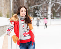 Young and pretty girl skating on an outdoor ice rink Royalty Free Stock Images
