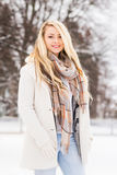 Young and pretty girl skating on an outdoor ice rink Royalty Free Stock Photos