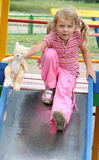 Young pretty girl on slide Stock Photography
