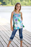 Young pretty girl standing on a dock. Stock Photography