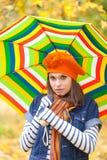 Young pretty girl with striped umbrella Stock Photo