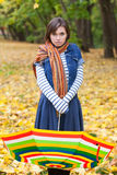 Young pretty girl with striped umbrella Royalty Free Stock Photos