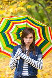 Young pretty girl with striped umbrella Stock Photo