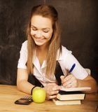 Young pretty girl student in classroom at Stock Images