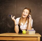 Young pretty girl student in classroom at Royalty Free Stock Photos