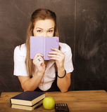 Young pretty girl student in classroom at Royalty Free Stock Images