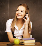 Young pretty girl student in classroom at Stock Photo