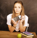 Young pretty girl student in classroom at blackboard Stock Photo