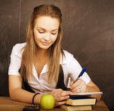 Young pretty girl student in classroom at blackboard Royalty Free Stock Images