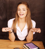 Young pretty girl student in classroom at blackboard. Doing homework Stock Photos