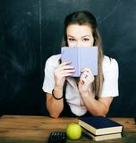 Young pretty girl student in classroom at blackboard doing homework Royalty Free Stock Photo