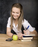 Young pretty girl student in classroom at Royalty Free Stock Image
