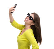Young pretty girl in sunglasses make self portrait selfie with h Stock Image