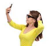 Young pretty girl in sunglasses make self portrait selfie with h Stock Photos