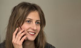 Young pretty girl talking on her mobile phone Royalty Free Stock Photo