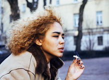 Young pretty girl teenage outside smoking cigarette close up, lo Royalty Free Stock Photo