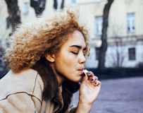Young pretty girl teenage outside smoking cigarette close up, lo Stock Photo