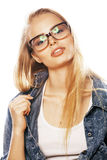 Young pretty girl teenager in glasses on white  blond ha Royalty Free Stock Images