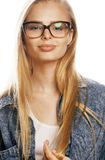 Young pretty girl teenager in glasses on white Royalty Free Stock Photography