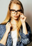 Young pretty girl teenager in glasses on white isolated blond hair modern hipster. Close up stock photos