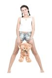Young pretty girl with teggybear. Young pretty girl with teddybear over white background Royalty Free Stock Photos