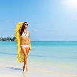 Young pretty girl on tropic island in summer near the sea Stock Images