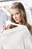 Pretty girl trying on clothes Royalty Free Stock Photos