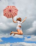 Young pretty girl with umbrella Stock Photos