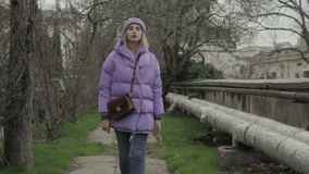 Young pretty girl walks, outdoor, cold weather stock video