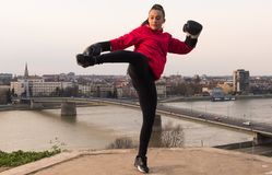 Young girl wearing boxing gloves throwing a punch - martial arts Stock Photos