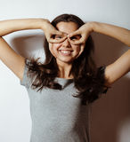 Young pretty girl on white background gesturing Stock Photography