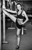 Young pretty girl work out in the gym Royalty Free Stock Images