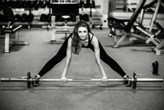 Young pretty girl work out in the gym Royalty Free Stock Photos