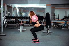 Young pretty girl work out in the gym Royalty Free Stock Photo
