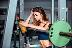 Young pretty girl work out in the gym Stock Photos