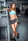 Young pretty girl work out in the gym Stock Images